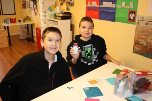 The boys are making ornaments to sell to raise money for Stop Hunger Now.